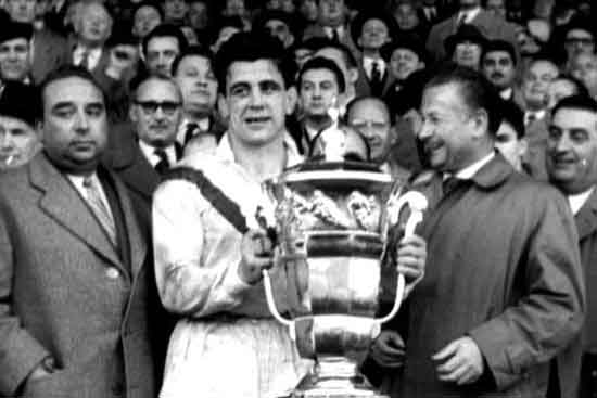 Captain of the winning British team, Dave Valentine, presented with the trophy at the inaugural Rugby League World Cup in 1954