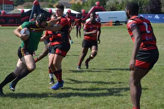 Lithunaia's Ernestas Lisauskas, their first ever try scorer, on the charge