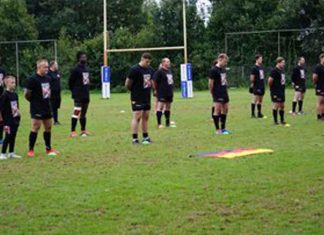German Rugby League players show respect Simon Cooper